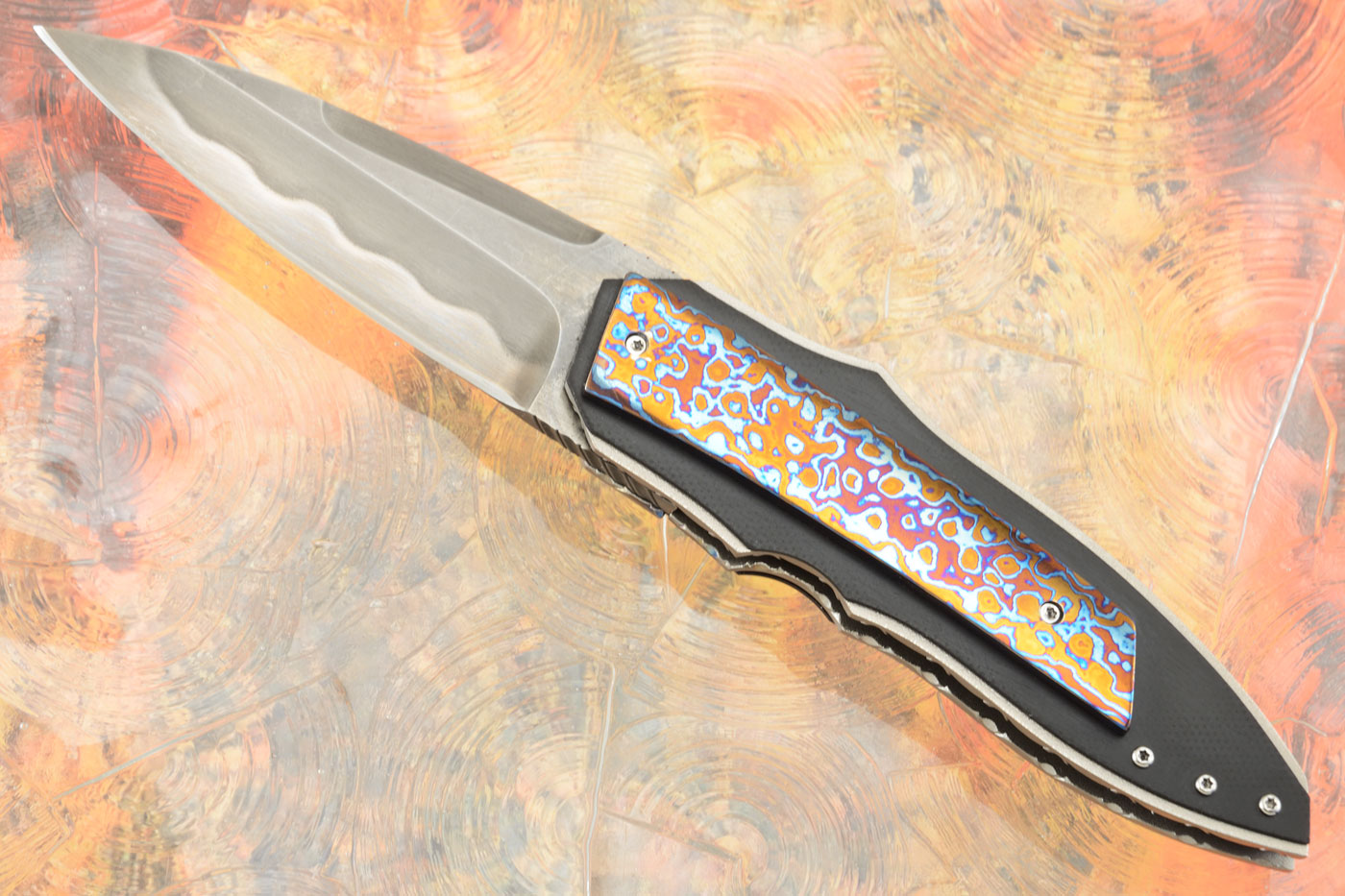X-Plain Front Flipper with Titanium Damascus and Marbled Carbon Fiber