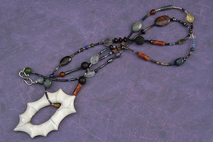 Fossil Walrus Ivory Starburst Pendant with Necklace
