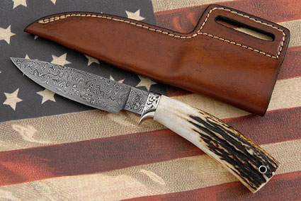 Engraved Damascus Hunter