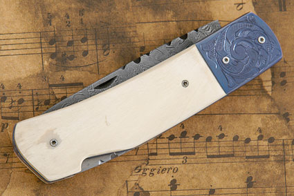 Blued Damascus and Mammoth Engraved Folder