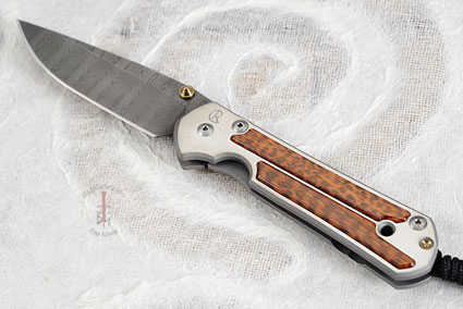 Large Sebenza 21 with Snakewood and Stainless Laddered Damascus