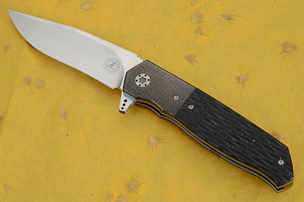 L36M Flipper with Jigged Black G10 and Carbon Fiber (IKBS)