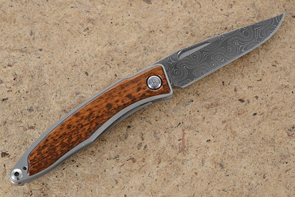 Mnandi with Snakewood and Raindrop Damascus - Left Handed