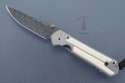 Large Sebenza 21 with Mammoth Ivory and Raindrop Damascus