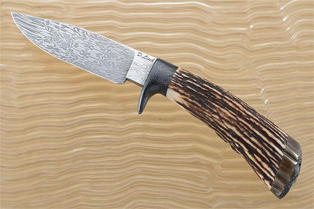 Carved Damascus Hunter