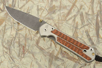 Large Sebenza 21 with Snakewood and Laddered Damascus