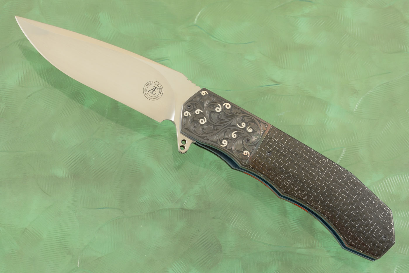 L44 Flipper - Silver Strike Carbon Fiber with Engraved Zirconium and Inlaid Silver (Ceramic IKBS) - M390