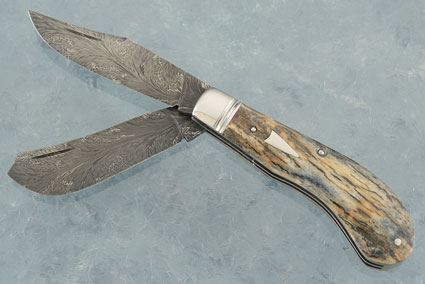 Dragon's Breath Damascus Two Blade Saddle Horn Trapper with Silver Mine Mammoth Ivory