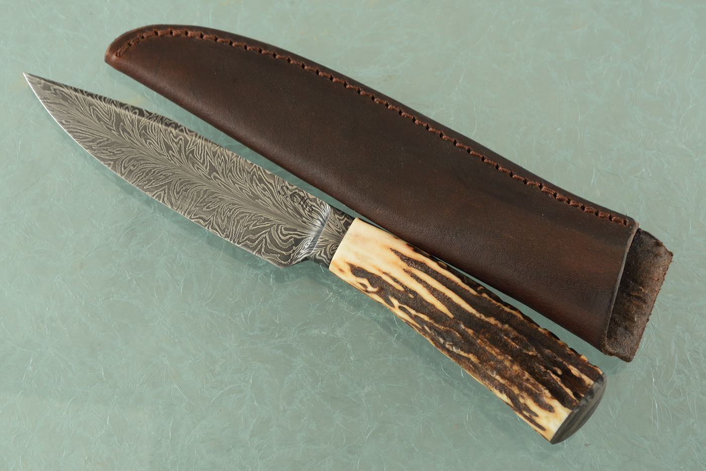 Integral Feather Damascus Hunter with Stag