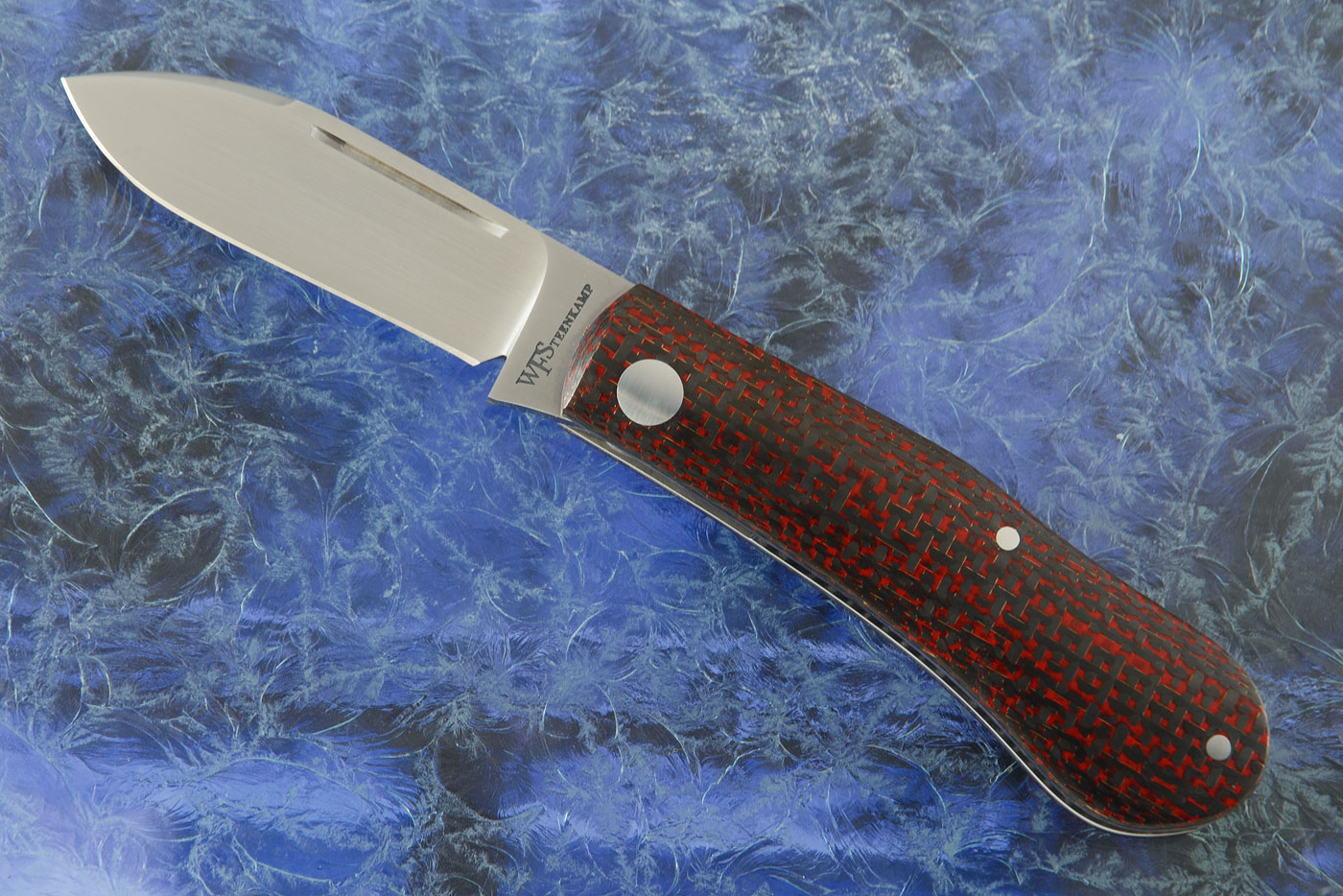 Dogleg Slip Joint Trapper with Red/Black Lightning Strike Carbon Fiber